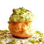 apricot and pistachio cream puffs on plate
