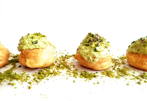 cream puffs sprinkled with pistachio