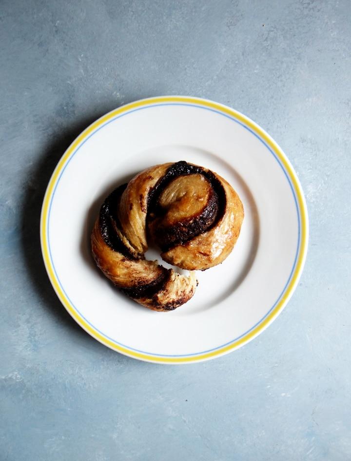 a chocolate bun on a plate