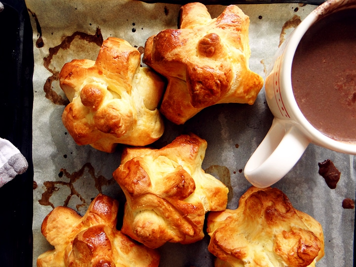 a cup of hot chocolate and pomme cannelle on a tray