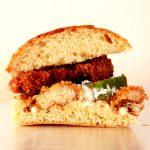 fried chicken burger in half