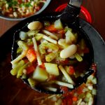 pistou soup in ladle