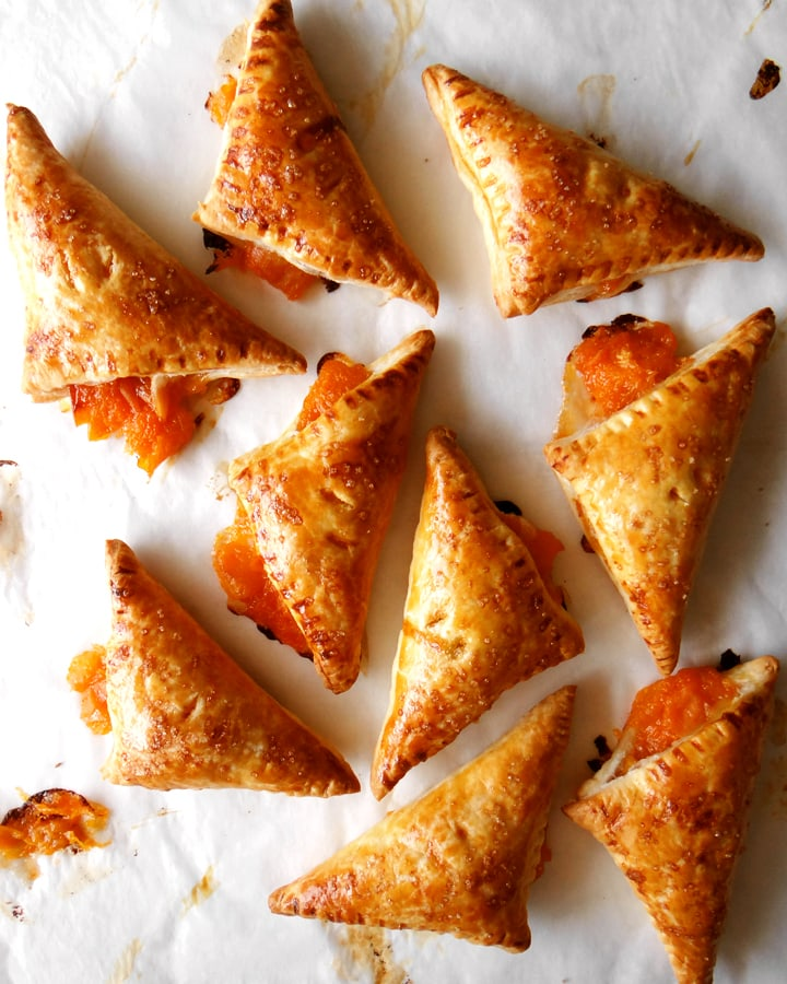 apricot turnovers on parchment paper