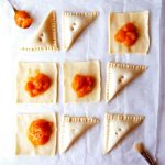 apricot turnovers on baking parchment