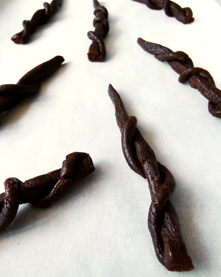 licorice wands on baking parchment