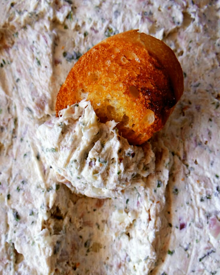 slice of bread on tuna dip