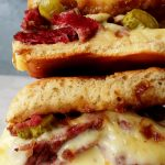corned beef sandwich on top of another sandwich