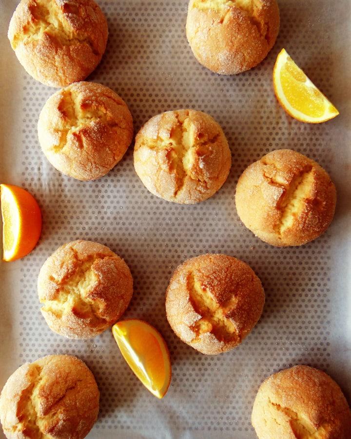 orange cookies on baking tray
