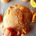 hand holding orange cookies