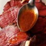 sauce spooned on rare roast beef