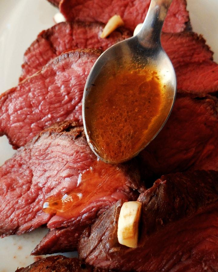 sauce on rare roast beef