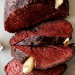 rare roast beef on serving plate