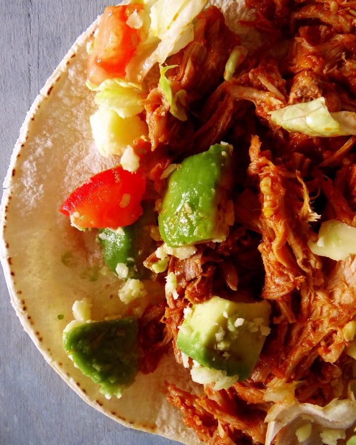 shredded pork tacos on table