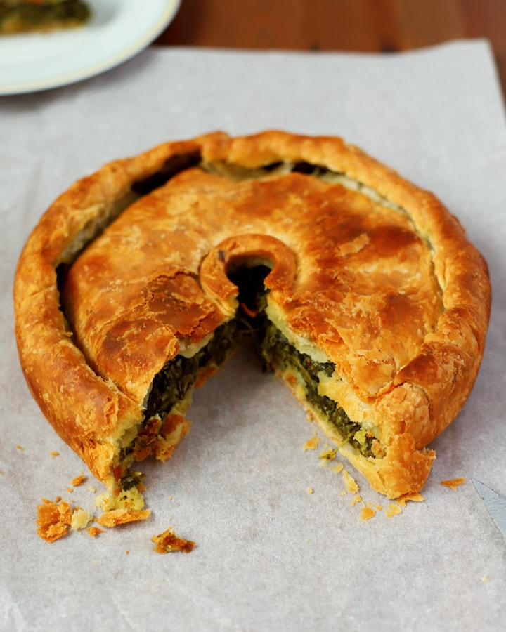 spinach and cheese pie on baking parchment
