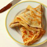 folded crêpes on a plate