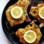 fried breaded pork chops in pan