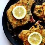 pan-fried breaded pork chops in pan