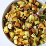 sauteed potatoes on a spoon