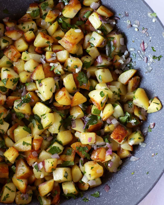 sauteed potatoes in a pan